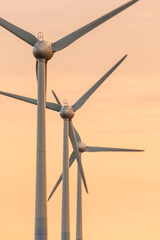 Row of wind turbines during sunset