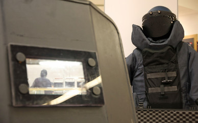 Blaster with the policeman armor and protective shield during a