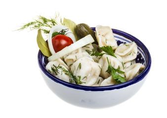 Bowl with traditional russian dish - pelmeni