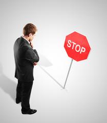 man and stop symbol