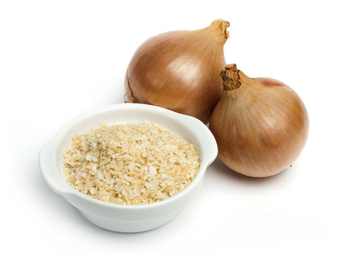 Mature onion and bowl with dried onion powder