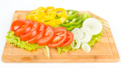 Fresh vegetable mix sliced on white background