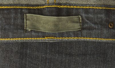 fabric jeans label sewed on a blue jeans.