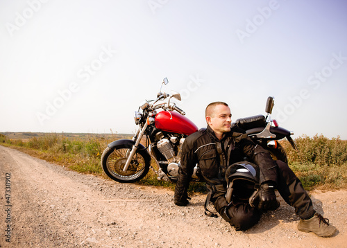 Wall mural Biker on the country road