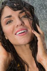 Joyful woman under rain