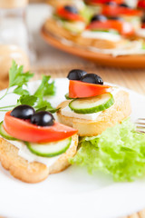 Canape with soft cheese and olives