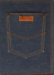 Fragment of jeans with pocket and label with text