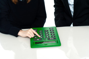 Cropped image of teacher and a student operating calculator