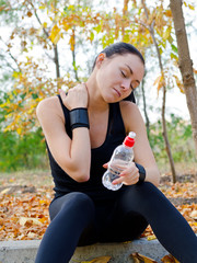 Woman athlete stretching her neck muscles