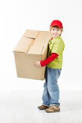 Boy holding big carton box, delivery service