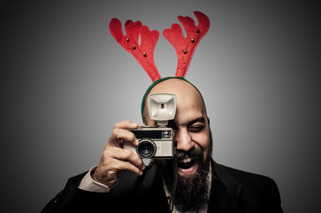 christmas bearded man holding old camera