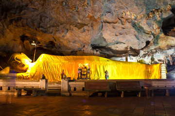 Reclining Buddha in a cave.