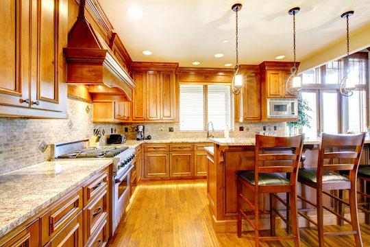 Luxury mountain home wood kitchen with island.