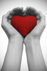 red heart holded by hands