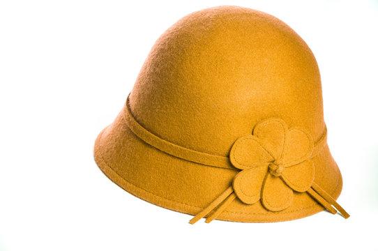 Yellow felt hat on white background.