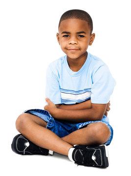 Sitting boy smiling