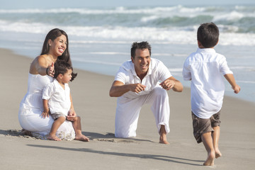Mother, Father & Children Hispanic Family At Beach