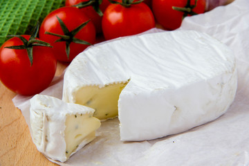 Brie cheese with cherry tomatoes