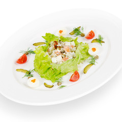 """russian salad """"olivier"""". isolated on white background"""