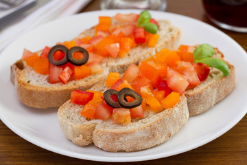 bread with tomato, pepper, olives and basil