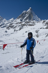 boy on the ski in front of the Matterhorn