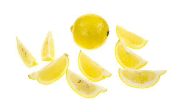 Lemon with lemon wedges