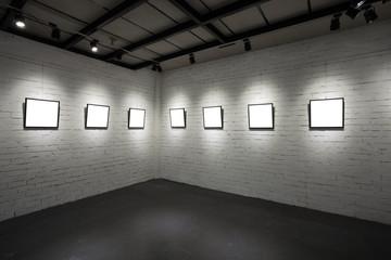 frames on white wall in art museum