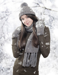 Beautiful young brunette with winter clothes