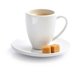 Cup of coffee with the cubes of sugar on white background