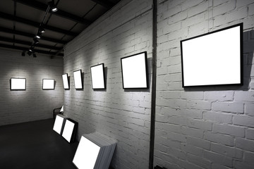 frames on white wall in art museum