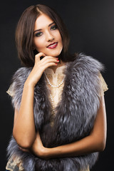 Wall Mural - Gorgeous woman in fur jacket