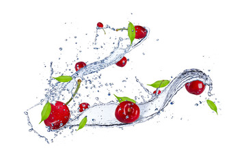 Cherries in water splash, isolated on white background