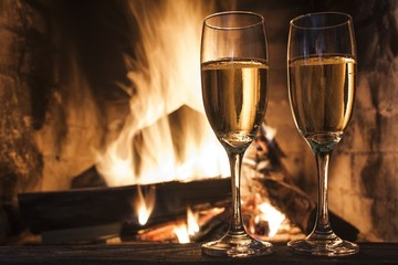 glasses of champagne in front of fireplace