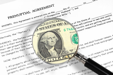 prenuptial agreement , magnifying glass and dollar note