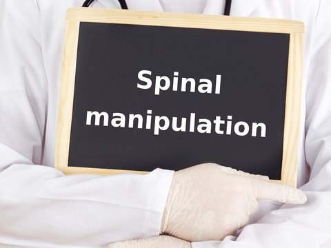 Doctor shows information: spinal manipulation