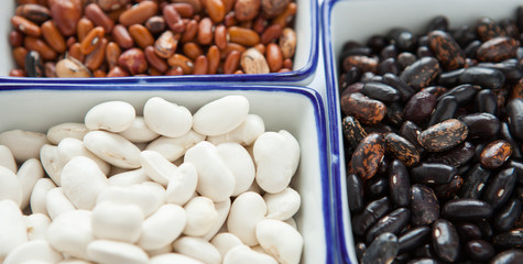 Different types of beans in containers