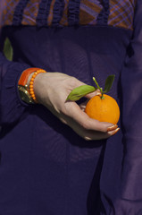 Orange in the woman hand
