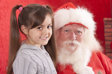 santa claus and pretty little girl