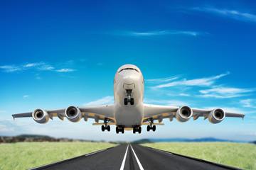 Large jet taking off runway