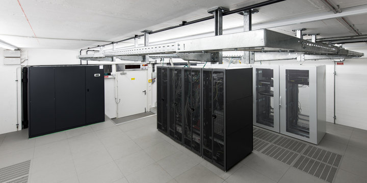 small air conditioned computer room with racks an cable trays