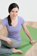 Portrait of healthy young lady practicing yoga exercise - Spine