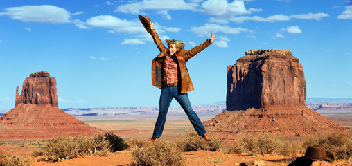 cowgirl jumping at Monument Valley