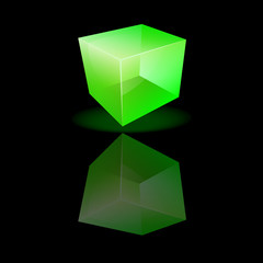 Green glass cube on a smooth surface