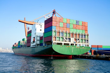 Green cargo ship in seaport