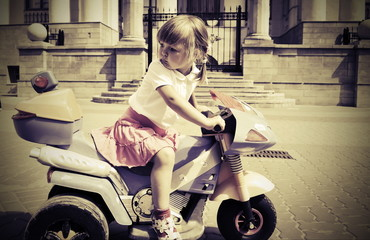 Fotomurales - Biker little  girl on a motorcycle