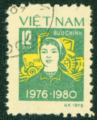 stamp printed in Vietnam shows woman with tractor