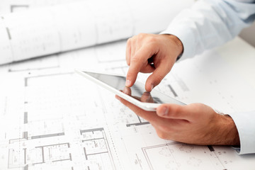 Architect working with digital tablet