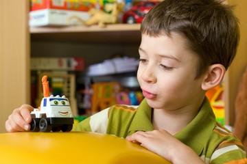 Fototapeta Boy playing with car © Profesja Bielsko