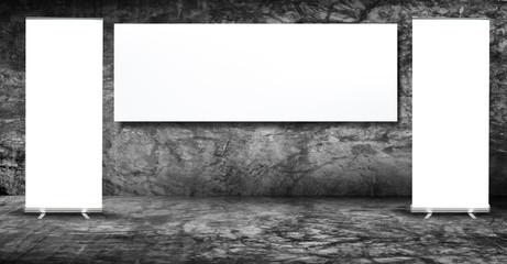 Blank advertising billboard in cement wall room.