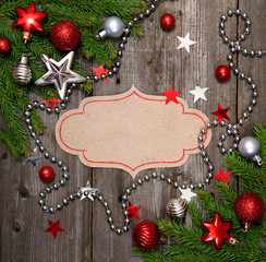 Christmas vintage card with baubles on wood texture.